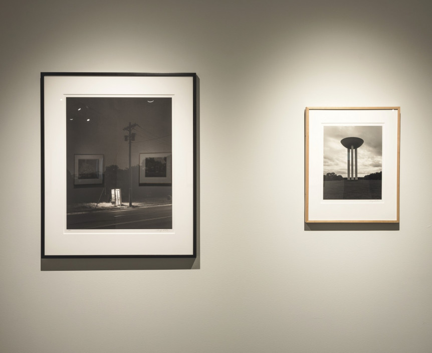 George Tice: Seldom Seen + Big Platinums, June 4 – September 6, 2015. Installation view.   left to right: Telephone Booth, 3a.m., Rahway, NJ, 1974. Water Tower, Holmdel, New Jersey, 2010.