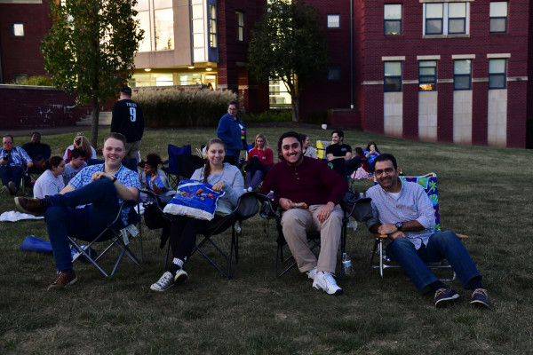 Ursinus families and friends enjoying a Movie on Paisley Beach.