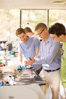 Sean Delany and Daniel Selechnik work with Dr. Dale Cameron to study prions in yeast.