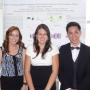 Tu Pham (right) presents his undergraduate research at CoSA in 2013 along with his fellow lab mem...
