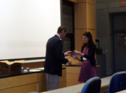 Prof. Mark Ellison presents 2nd place award in the Inorganic Chemistry division to Allison Arinaga at the 80th ISCC