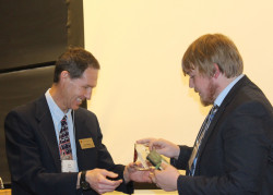 Prof. Mark Ellison presents 1st place ISCC award in the Physical/Analytical divison to Samual Menges