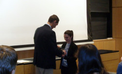 Prof. Mark Ellison awards 2nd place in the Biological Chemistry II division to Katie Fiocca at the 80th ISCC