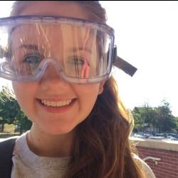 Brooke Moses in science lab glasses