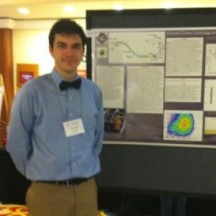 Usrinus Student displaying his work