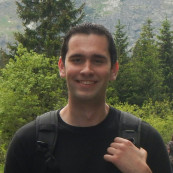 Christopher Sadowski standing in front of a mountain range