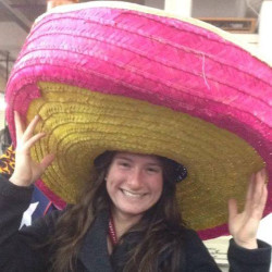 Julia Senkevich posing with a large sombrero