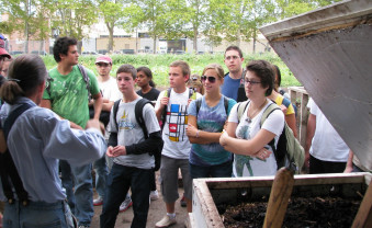 Learning about compost at the Added Value urban farm in Brooklyn, NY.