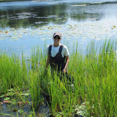 Jessie Kemper working to remove invasive species from our waterways.