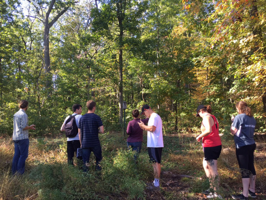 Students get a sense of the yard-forest interface on the property.