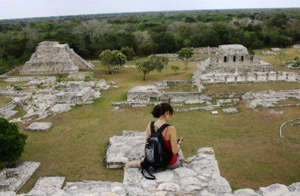 Regan Dohm looks out at the ruins of Mayapan from atop its central pyramid (Yucatan Peninsula, Mexico)