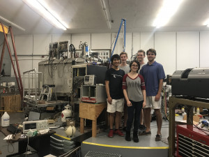 Jessica Nebel-Crosson (UC '21) and collaborators in front of the Super Enge split-pole spectrog...