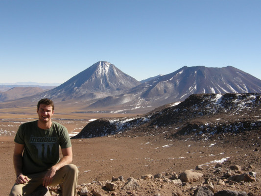 Jon Ward '13 working high in the Andes, where conditions are ideal for the telescopes used in his research.