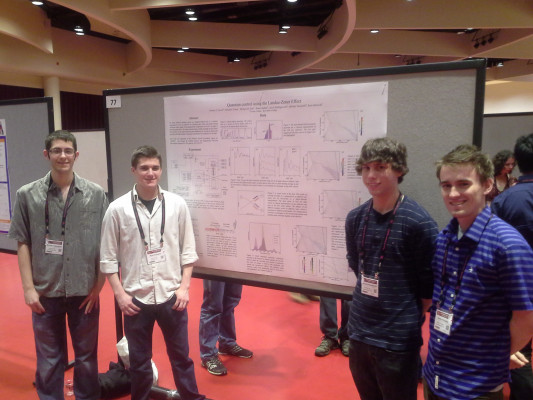Mike Vennettilli, Jake Hollingsworth, Tamas Budner, and Ryan Zmiewski presenting their research at DAMOP 2015 in Madison, WI.