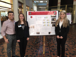 Research students Joseph Cruz, Allyson Getty and Tia Wisdo poster presentation.