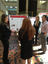 Students discuss poster with staff, Senator Wagner 's office