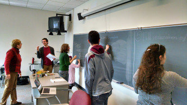 Students collaborating at the chalkboard