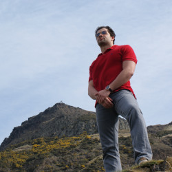 Vincent Razzano standing in front of a mountain