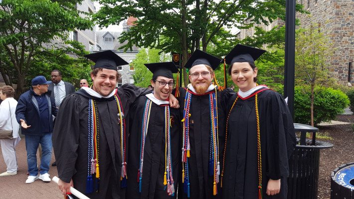 History majors celebrating at commencement--and just look at all the honor cords!