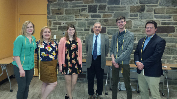 The German group show their academic pride. (From left, Kathryn Bormann, Hannah Engber, Sarah Wonsidler, Prof. Clouser, John (Zach) Runk, Brendan Werner)