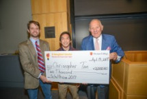 Chris Tan ('18) receives the award for winning the 2017 Schellhase contest. Pictured left to right are contest director Scott Deacle, Tan, and contest donor Will Abele ('61).