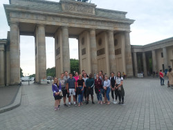 Ursinus students on the Economies in Transition study abroad trip stand in front of the Brandenburg Gate in Berlin.