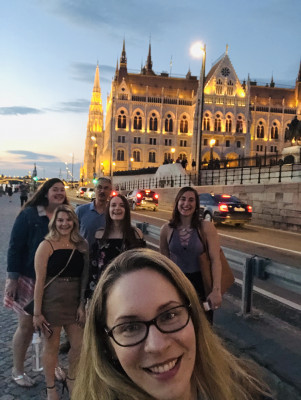 Hungarian Parliament Building, Budapest, Renee (UC '20), Emma (UC '22), Cassidy (UC '22), Hailey (UC '21), and Dr. E, Budapest, ECON 223, Study Abroad course in economics, summer 2019.