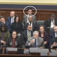 Paul (circled) covering a House Financial Services Committee hearing, reporting back to stakehold...
