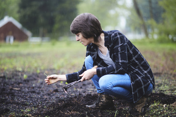 Student working at the organic farm