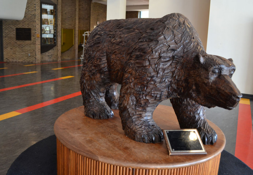 This bear statue, which sits in the lobby of Helfferich Gym, was carved from the original sycamor...