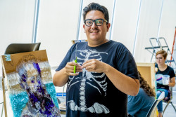 In the Berman Museum of Art, artist Justin Favela has spent several weeks working on a large piñata piece with the help o...