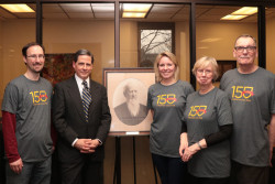 Bomberger stands with a photograph of his great-great-grandfather with members of the Ursinus community.