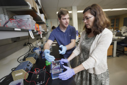 Brennan McFarland '16 (left) and Rebecca Kohn, professor of biology and associate dean of the college, work on C. elegan...