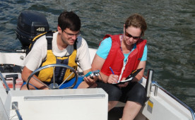 Michael Gasbarro studies water quality with biology professor Kate Goddard Doms.