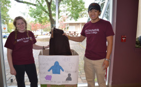 Thamden Wangyal and Kelly Johnson are collecting clothing for an area shelter.