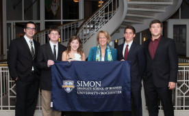 Ursinus students at the Simon competition in 2012 with professor Carol Cirka.