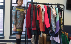 Senior Rebecca Fong shows off some of the hundreds of clothes donated for a fashion show. Proceeds go toward helping educa...