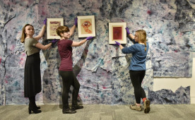 Students in a museum studies course curate an exhibition in 2017.