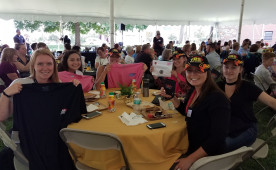 Ursinus students who participated in the annual community conference show off items won during a raffle.