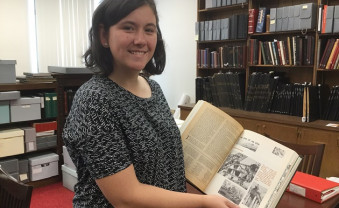 Shelby Bryant '18 looks through the Ursinus College archives for Bears Make History. She is one of the first digital ...
