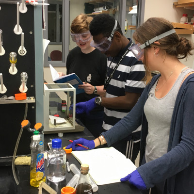 Lilly McQueen '19, Kevin Brown '22, and Noel McCampbell '20 working in the research lab.