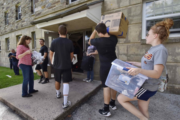 Moving into the residence hall.