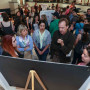 Faculty and students learn about a poster presentation.