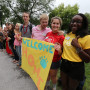 New students are cheered and greeted as they leave Bomberger.