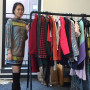 Senior Rebecca Fong shows off some of the hundreds of clothes donated for a fashion show. Proceed...