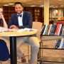 UCSG President Abi Wood and Vice President Hermes Paez check out the new textbooks for the Textbo...
