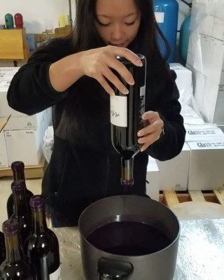Amanda Palladino is a natural when it comes to wax dipping at her externship at Chaddsford Winery.
