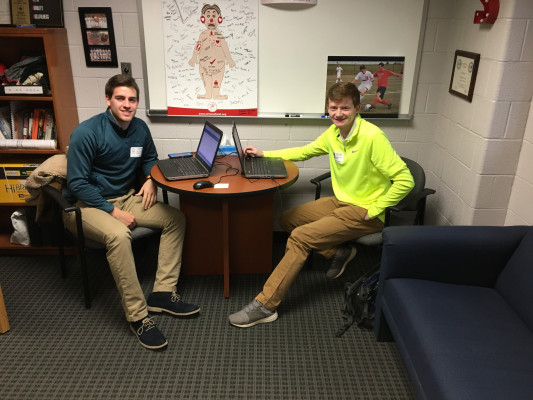 Matt Margolis '19 and Jon Cope '19 shadow Dennis Stanton '04, Athletic Director at Souderton Area High School.
