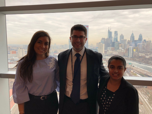 Faratha Rathod '19 and Mariana Arrisueno '18 shadow Patrick Higgins '08 at Penn Medicine, University of Pennsylvania Health System.