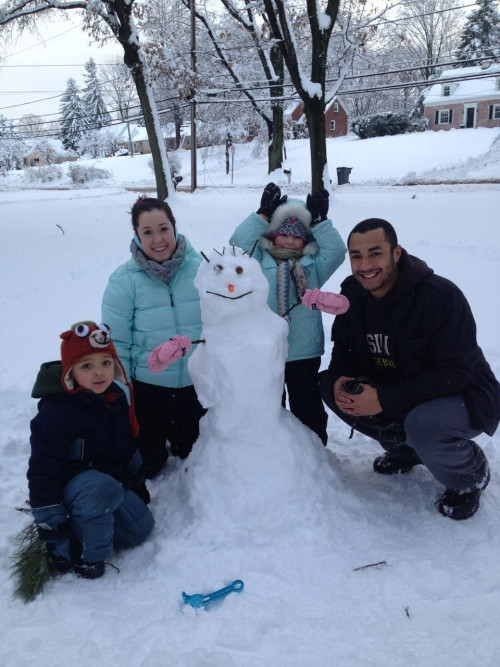 Photo of family with their snowman